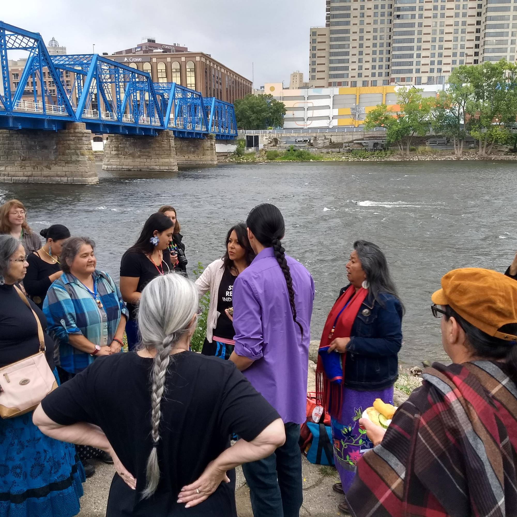 gathering of Native individuals at shore of Grand River in Grand Rapids, MI